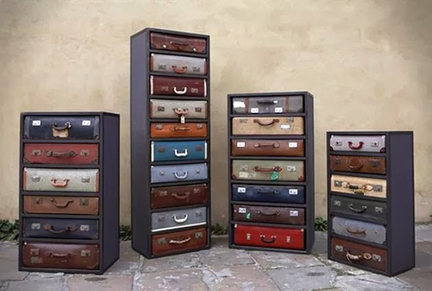 vintage luggage. the useless suitcases are refurnished that gives a different look of place where it is being placed. vintage dressers can be purchased online. luggage