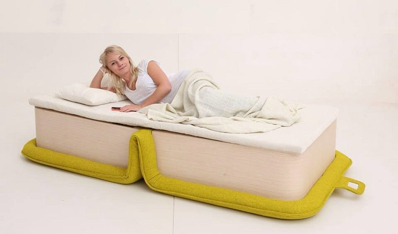 Multifunctional-Arm-Chair-With-a-Bed-Attached-02