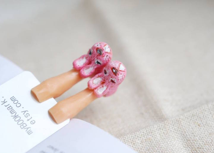 Quirky Bookmarks Look Like Tiny Legs of Literary Characters Sticking Out Between Pages 11
