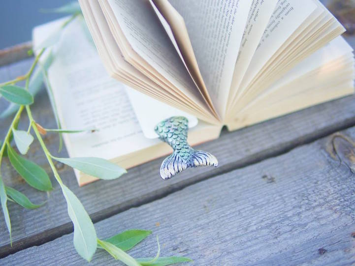 Quirky Bookmarks Look Like Tiny Legs of Literary Characters Sticking Out Between Pages 4
