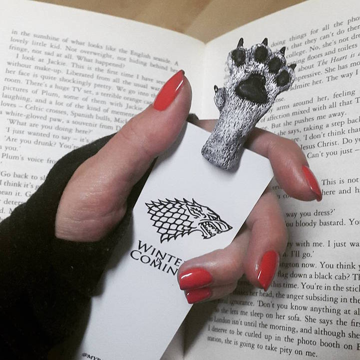Quirky Bookmarks Look Like Tiny Legs of Literary Characters Sticking Out Between Pages 6